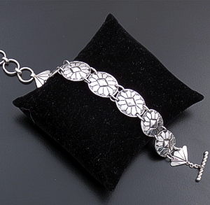 Anne Pabcito Valencia (Navajo) - Oval Concho & Fan Stamped Sterling Silver Bracelet #42166 $175.00